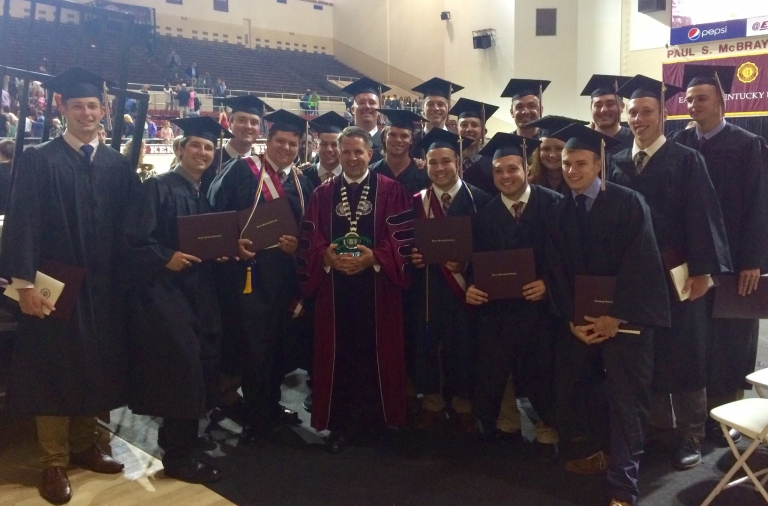 EKU President Benson (center) with PGM graduates
