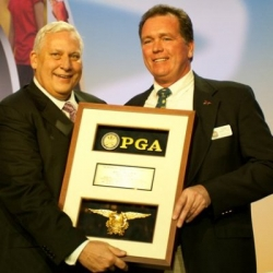 John V. Hines (right) accepting PGA award