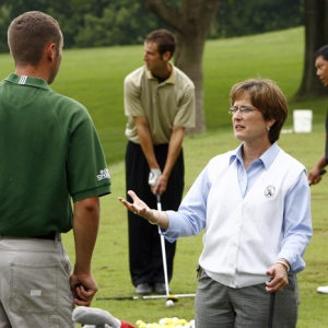 Kim Kincer instructing students at the golf course